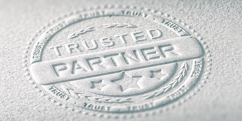 trusted partner embossed paper
